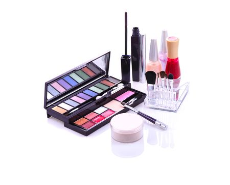 makeup set with eyeshadows, lip gloss, powder, mascara stick, brushes, nail polish photo