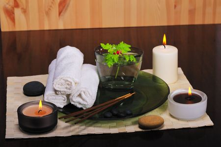 incense sticks: spa still life with candles, incense sticks, white towels,pebbles