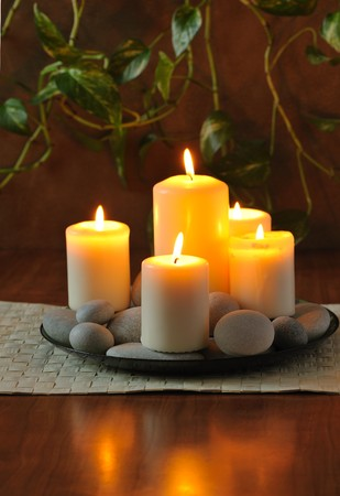 still life with white  burn candles and  pebbles   Stock Photo