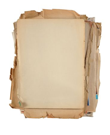 yellowed: yellowed  stacked  sheets of old paper isolated on white