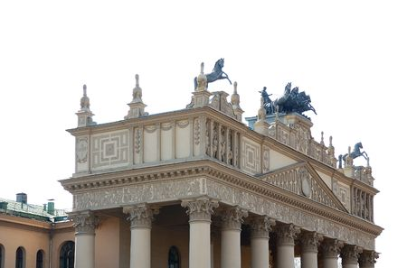 quadruple: bronze statue of horse on building roof