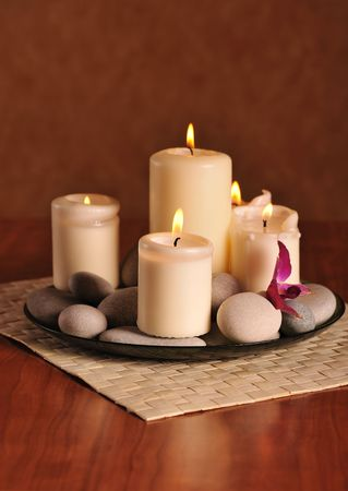 stil life with white burn candles and pebbles   photo