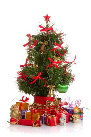 toygift: decorated Christmas fir tree with gifts on wnite Stock Photo