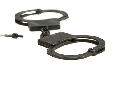 black handcuffs close up  isolated on white Stock Photo - 5960297