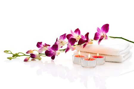spa candles: white towels,pink orchid, pink  burn candles on white