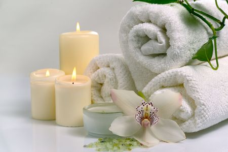 scented candle:  spa concept with orchid flower and  burn candles   Stock Photo