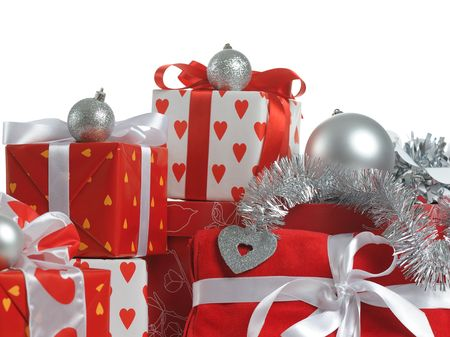 silver balls: heap of Christmas red gifts decorated with silver balls and tinsel on white background