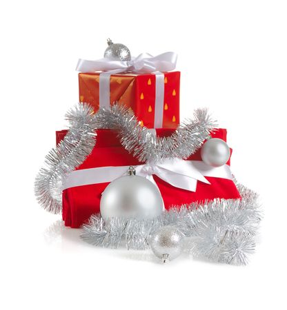 heap of Christmas red gifts decorated with silver balls and tinsel on white background photo