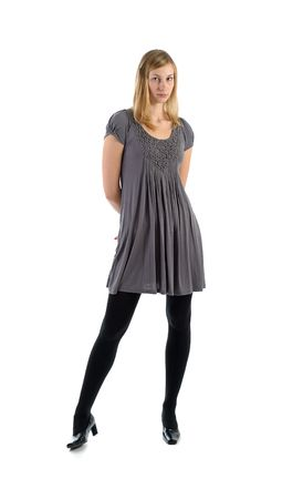 tricot:    young attractive blonde  girl in tricot grey dress  Stock Photo