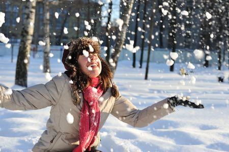 funny  teenager  girl playing in deep  snow photo