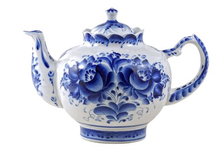 white brewing teapot decorated with blue patterns isolated on white  photo