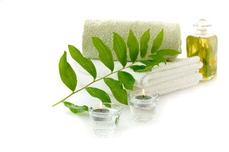 tincture: spa with herbal tincture and green leaf on white