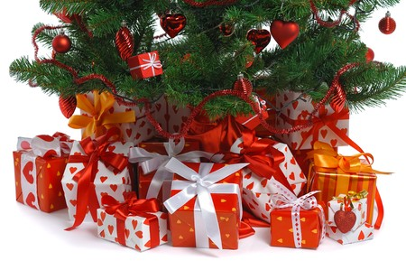 christmas toy:  heap of  red  gifts under decorated Christmas tree  Stock Photo