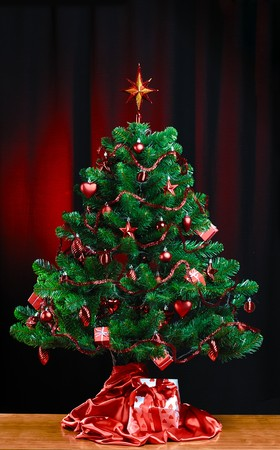 decorated Christmas tree on dark background Stock Photo - 7969988