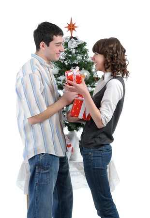 happy young couple  with Christmas gifts  against decorated Christmas tree. isolated on white background photo