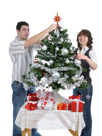 happy young couple decorating Christmas tree,  isolated on white background photo