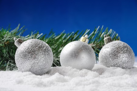 Christmas silver balls on snow against blue background Stock Photo - 8224221