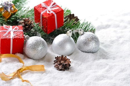 Christmas red  gifts and balls on snow photo