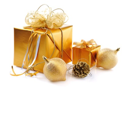 golden Christmas gifts with balls on white  background