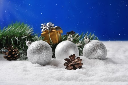 adorning:  gift  and silver balls on snow in Christmas nignt Stock Photo