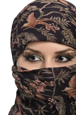 niqab: portrait of beautiful eastern woman wearing nigab