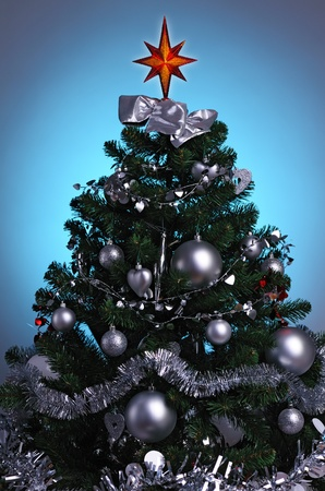 decorated Christmas tree in blue glow background Stock Photo - 8463748