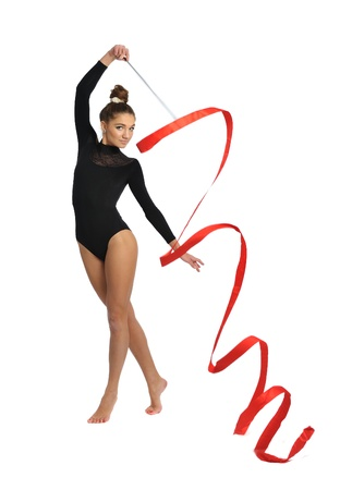 female gymnast: girl gymnast in black sport  suit with red ribbon isolated on white background
