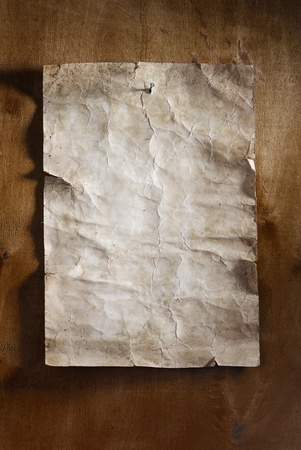 old paper on brown wood  photo