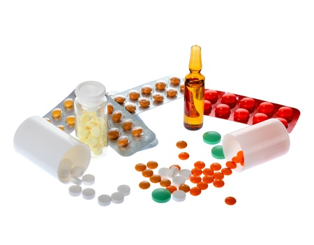 a lot of colorful pills and ampoules on white background photo