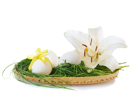Easter eggs in basket with white lily  on white background Stock Photo - 8994474