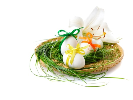 Easter eggs in basket with white lily  on white background Stock Photo - 8994477