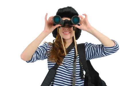 traveller young girl dressed in sailors with binocular on white background photo