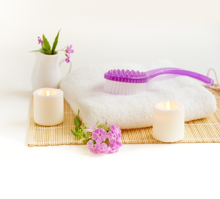 white  burn candles with lilac brush and flowers   photo