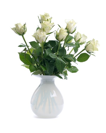 bunch of white roses in glass white vase isolated on white background photo
