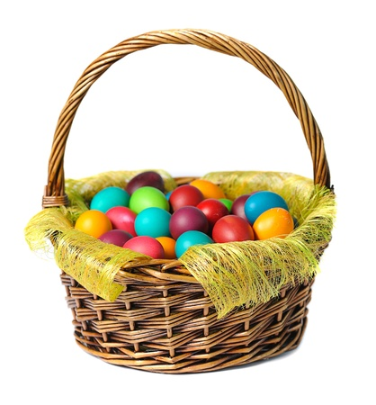 Easter eggs in basket with white lily  on white background photo