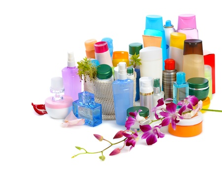 set of  body cosmetics with flower on white background photo