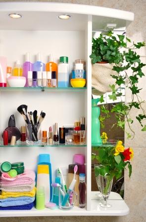 white bathroom shelf with cosmetics and  toiletries Stock Photo
