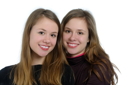 18's: portrait of  happy twin sisters isolated on white