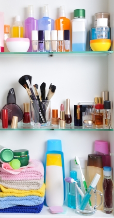 toiletries: white bathroom shelf with cosmetics and  toiletries Stock Photo