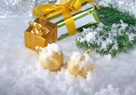golden Christmas gift boxes  on snow photo