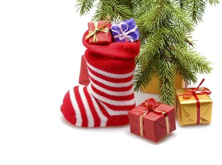 red santa stocking isolated on white background photo