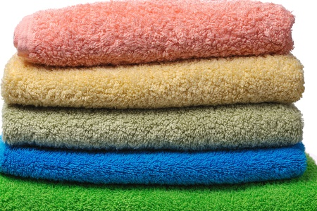yello: stack of colorful towels isolated on white background Stock Photo