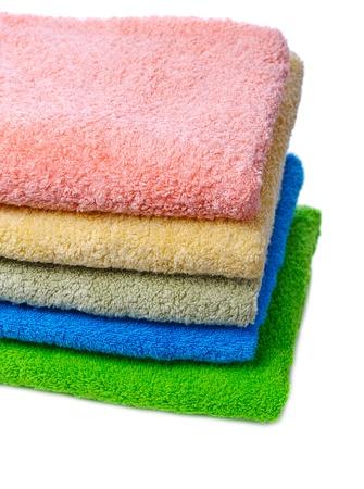 stack of colorful towels isolated on white background photo