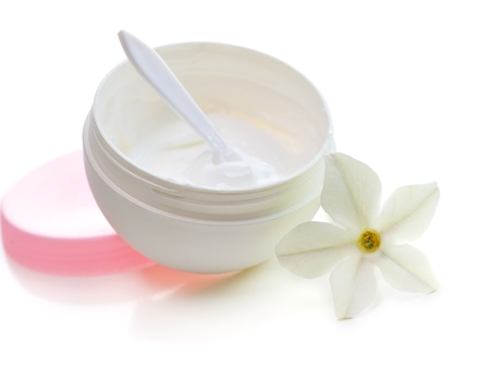 face cream with flower isolated on white background photo
