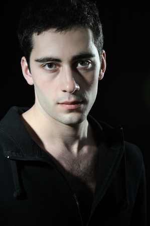 european expression face:  portrait of young  handsome man  on dark background