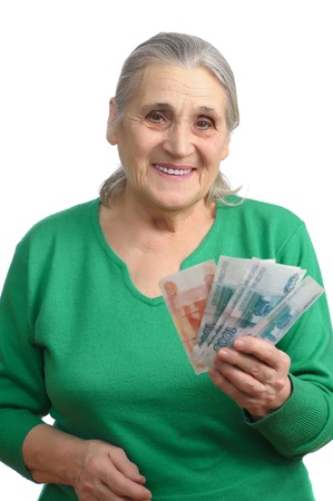 woman holding money: old woman with money isolated on white background Stock Photo