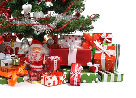 toygift:  heap of festive gift boxes under decorated Christmas tree