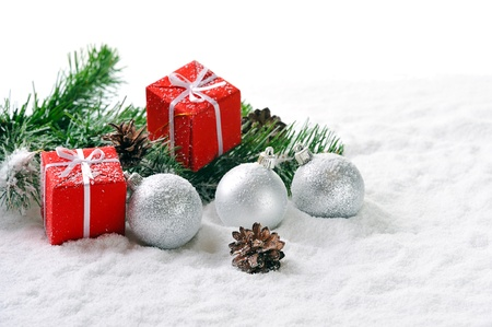 Christmas red gifts and silver balls on snow photo