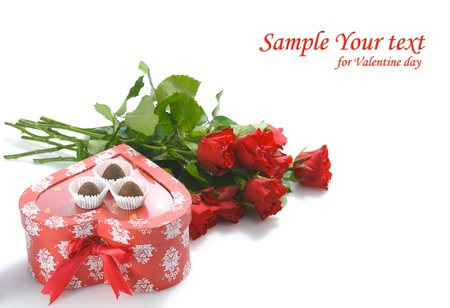 bunch of red roses and  heart-shaped gift with chocolate for St.Valentines Day  photo