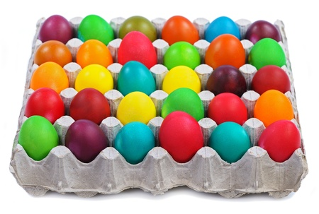 egg carton: colorful easter eggs in carton isolated on white background Stock Photo